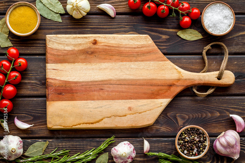Poster Cuisine Chef work space with products and cutting board on wooden background top view mock up