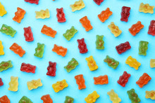 Delicious Bright Jelly Bears On Blue Background, Flat Lay