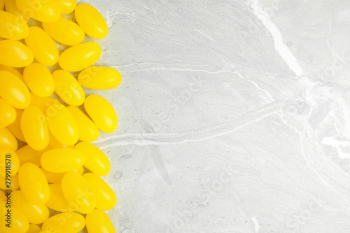 Flat lay composition with jelly beans on light background. Space for text