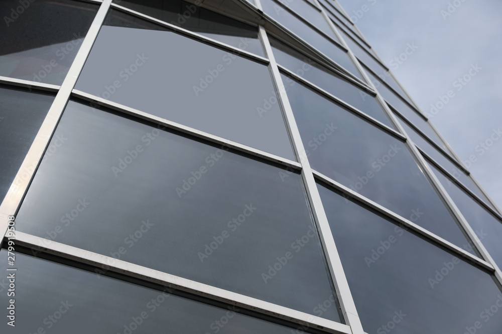 Fototapety, obrazy: Modern building with tinted windows, low angle view. Urban architecture