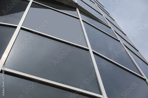 Fototapeta Modern building with tinted windows, low angle view. Urban architecture obraz