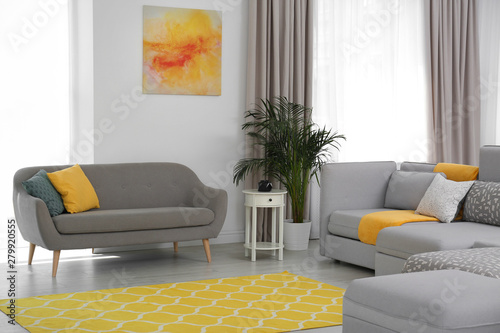 Living room with modern furniture and stylish decor. Color ...