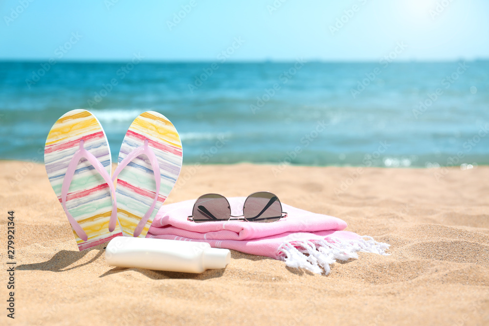 Fototapeta Set of different beach objects on sand near sea. Space for text