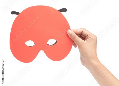 Valokuvatapetti Hand holding Bug carnival mask isolated on white background