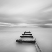 View Of Pier Over Sea Against Cloudy Sky
