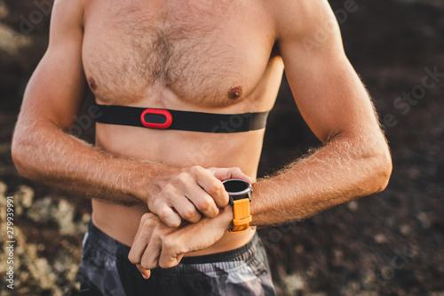 Fotografie, Obraz Athletic man start running program on smart watch or fitness tracker