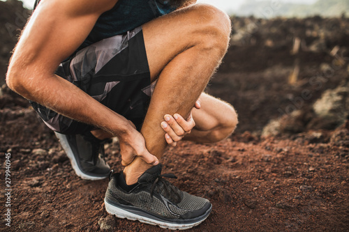 Achilles injury on running outdoors Wallpaper Mural