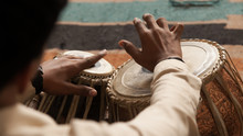 Man Playing A Drum Or Indian Classical Musical Instrument Tabla