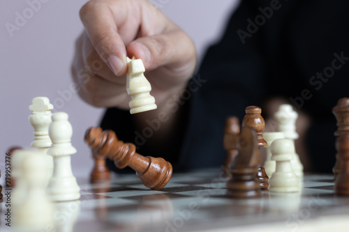 Poster Fleur Close up shot hand of business woman playing the chess board to win by killing the king of opponent metaphor business competition winner and loser select focus shallow depth of field