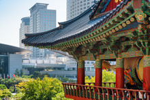 Colorful Roof Of Buddhist Temple And Scenic Modern Buildings