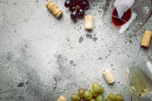 Red And White Wine With Glass, Bottle And Grapes Over Gray Stone Background, Copy Space , Top View.