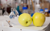 Apples on background with lab tools