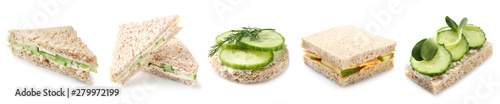 Tasty sandwiches with cucumber on white background