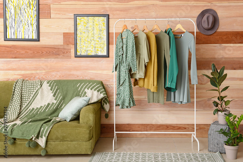 Photo Rack with hanging clothes in interior of dressing room