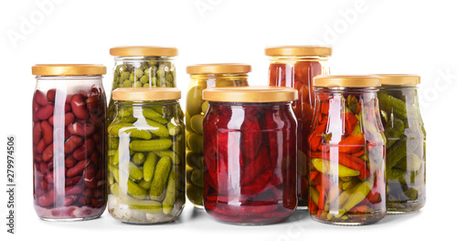 Pinturas sobre lienzo  Jars with different canned vegetables and legumes on white background
