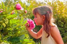 Happy Little Girl Smelling Fra...