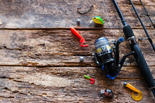 Kurgan, Russia-June 19, 2019 Fishing Tackle On A Wooden Background With Space For Text. Spinning Hooks Silicone Bait