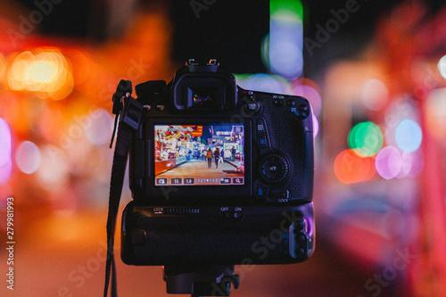 Cuadros en Lienzo Photograph of a camera doing long exposure in a fun fair. France.