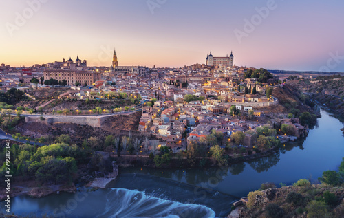 Beautiful view of Toledo city skyline with Cathedral, Alcazar and Tagus River at sunset - Toledo, Castila La Macha, Spain