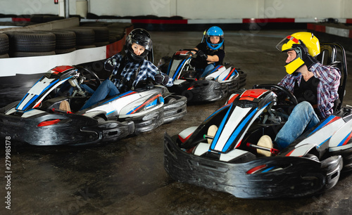 Valokuva  People driving go-kart cars