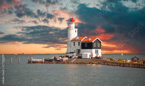 Lighthouse in the Dutch old village Wallpaper Mural