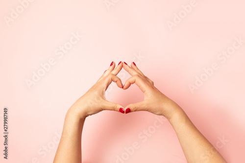 Aluminium Prints Manicure Woman making heart with her hands on pink background