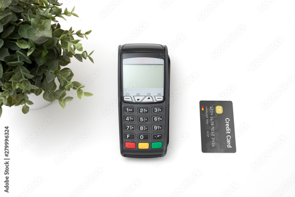 Fototapeta Payment terminal with credit card top view