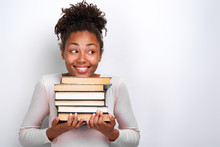 Portrait Of Happy Nerd Young Girl Holding Books Over White Background. Back To School