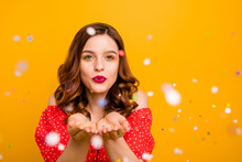 Photo Of Amazing Lady Blowing Shiny Confetti Making Fairy Tale Wear Red Dress Isolated Yellow Background
