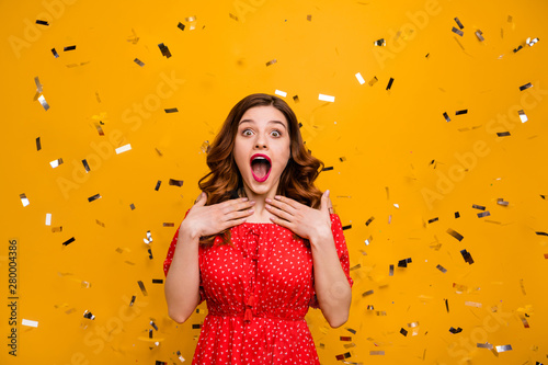 Photo  Pretty foxy lady surprised by unexpected birthday party arranging wear red dress