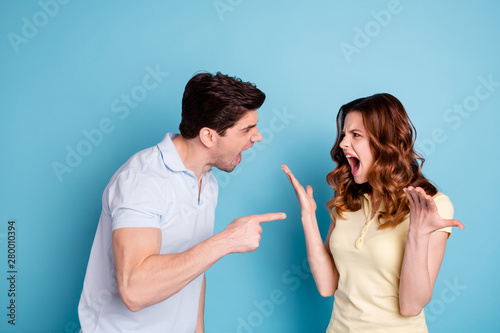 Vászonkép  Photo of irritated wild yelling pair it's your fault negative expression wear ca