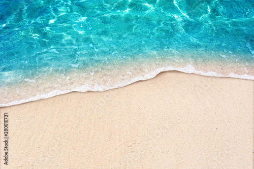 Deurstickers Strand Soft blue ocean wave on clean sandy beach