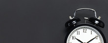 Black Retro Alarm Clock On Gra...