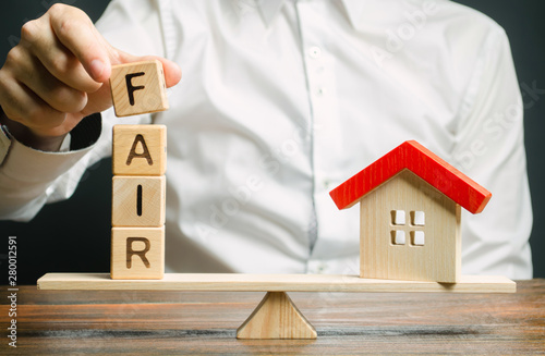 Wooden blocks with the word Fair and a wooden house Slika na platnu