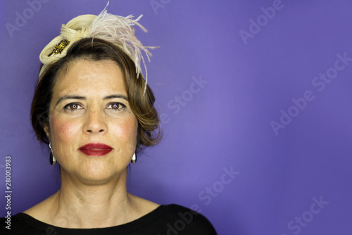 Photo  Portrait of mature woman combed and made up style forties