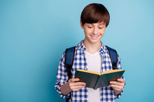 Portrait Of Pretty Boy Holding Printed Textbook Wearing Checked Plaid Shirt Isolated Over Blue Background