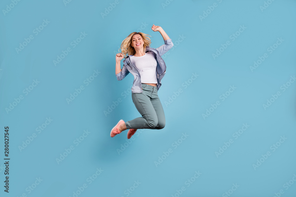 Fototapeta Full body photo of pretty lady raising arms wearing pants trousers isolated over blue background