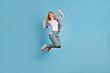 canvas print picture - Full body photo of pretty lady raising arms wearing pants trousers isolated over blue background