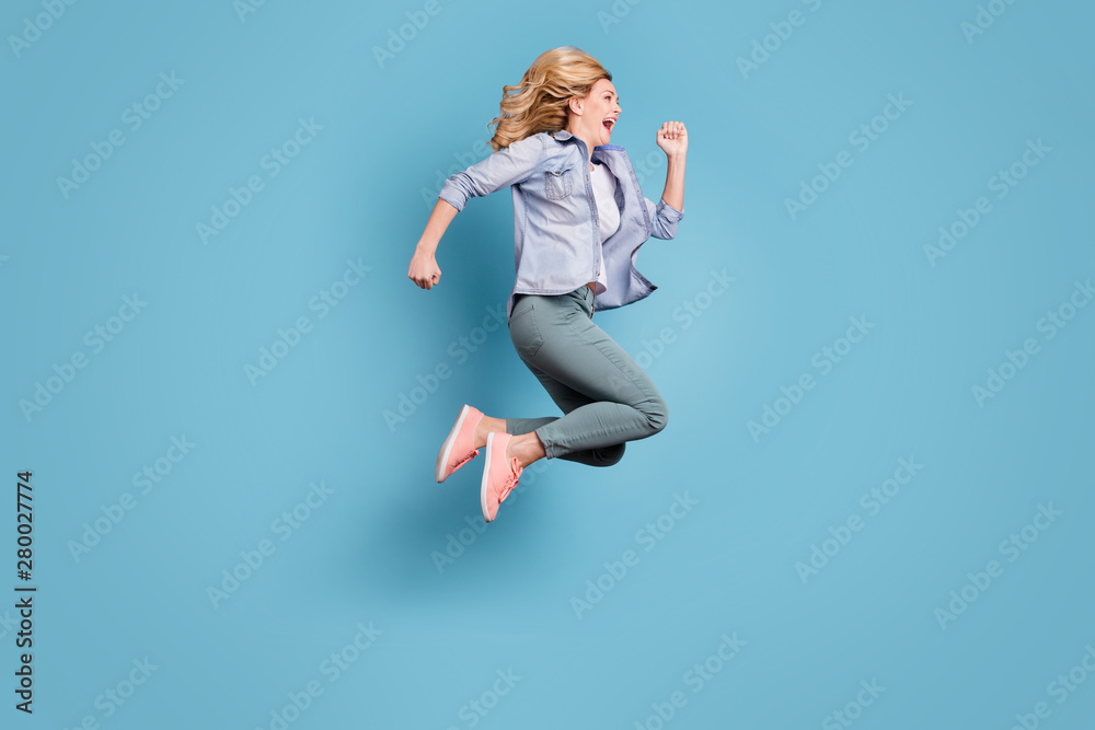 Fototapeta Full size profile side photo of cheerful lady shouting running moving wearing pants trousers isolated over blue background