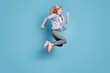 canvas print picture - Full size profile side photo of cheerful lady shouting running moving wearing pants trousers isolated over blue background