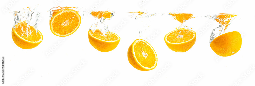 Fototapety, obrazy: Bunch of organic orange halves sinking into crystal clear water with air bubbles. Panoramic view
