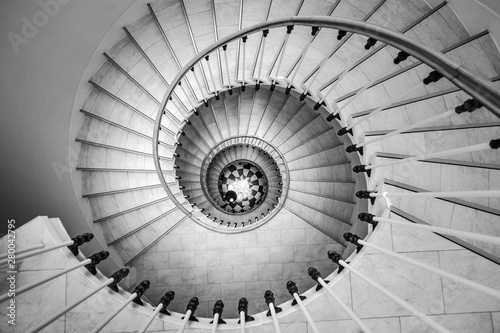 Fotografia  Beautiful circular staircase in old house, snail geometry