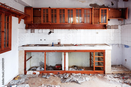Fototapeta Interior of an abandoned ruin house kitchen