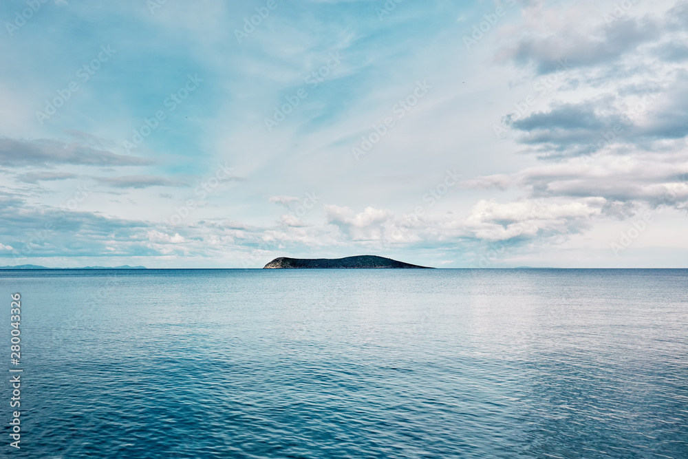 Fototapety, obrazy: Beautiful minimalist nature background of an island and blue sea at sunrise. Freedom, refreshment, tranquility and adventure holiday.