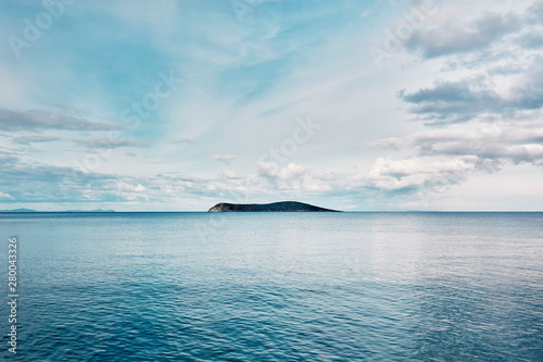 Foto auf AluDibond Pool Beautiful minimalist nature background of an island and blue sea at sunrise. Freedom, refreshment, tranquility and adventure holiday.