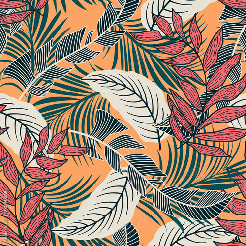 Trend seamless pattern with colorful tropical leaves and plants on yellow background. Vector design. Jungle print. Flowers background. Printing and textiles. Exotic tropics. Fresh design.
