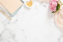 Stylish Composition With Pink Hydrangea Flower, Pastel Blanket, Paper Notepad And Accessories On Marble Background. Flat Lay, Top View, Overhead
