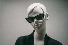 Female Mannequin In Sunglasses In Boutique. Dummy Head Close Up In Fashion Store