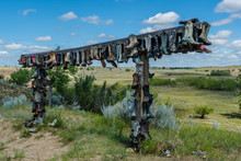 Old Cowboy Boots Hanging On A Post In The Great Sandhills In Saskatchewan, Canada