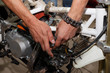 Master dismantles the motorcycle to work on the electric part of the motorcycle